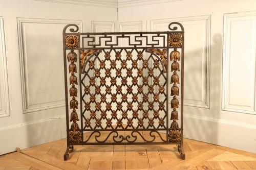 Ecran de cheminée, fer forgé partiellement doré, époque Louis XVI, Provence.