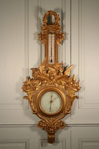 Baromètre de l'Amour, bois sculpté et doré, époque Louis XVI.