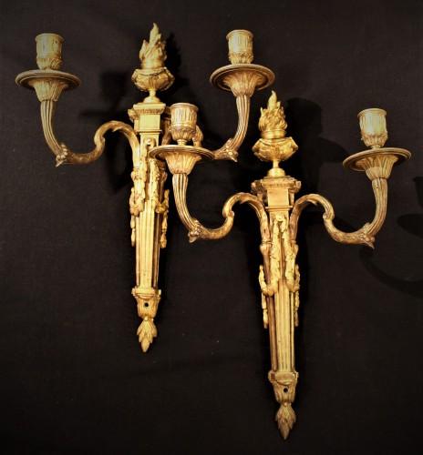 Paire d'appliques en flambeaux Louis XVI
